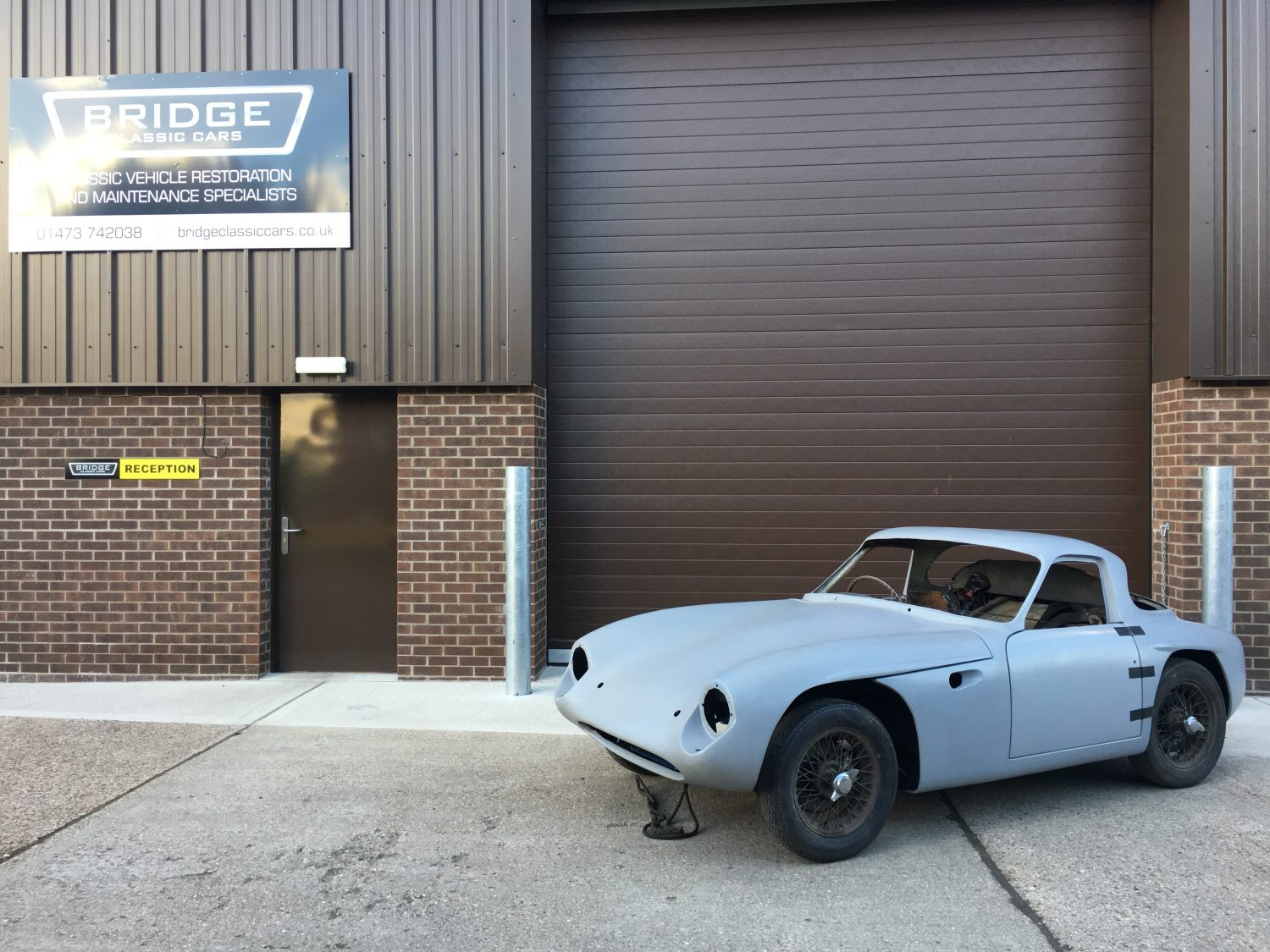TVR Grantura bodyshell arrives at Bridge Classic Cars