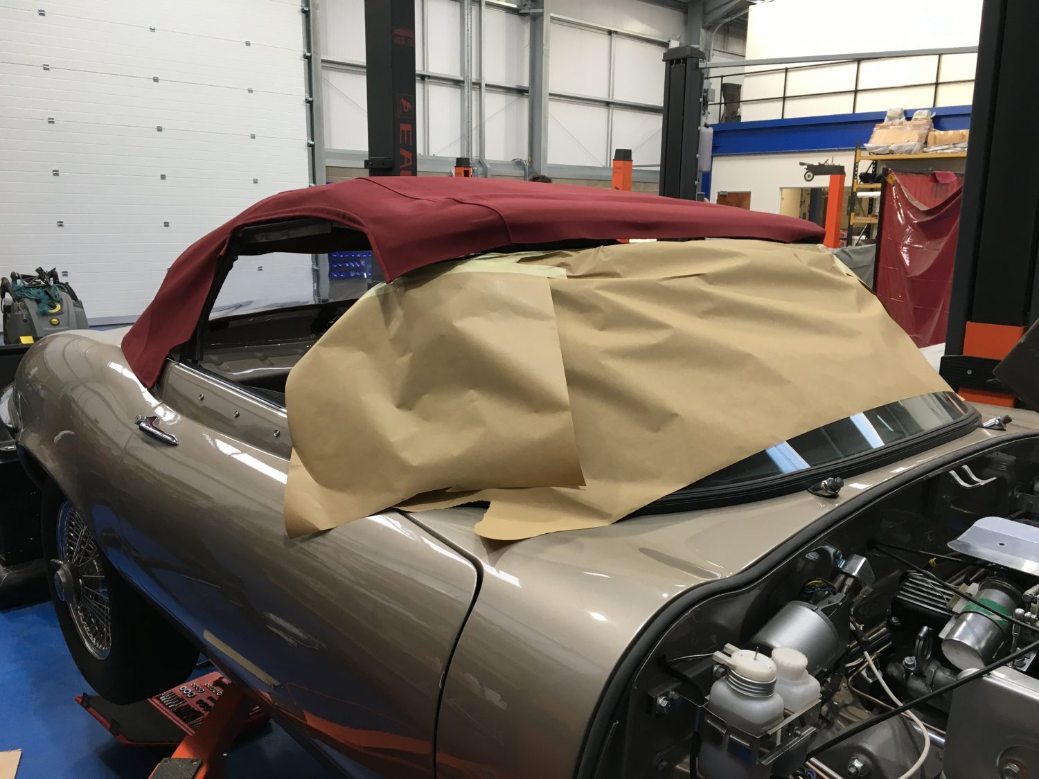 Fitting the hood and storage box in our Jaguar E-Type roadster